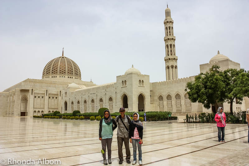 Standing outside the minaret of the Sultan Qaboos Grand Mosque in Muscat Oman