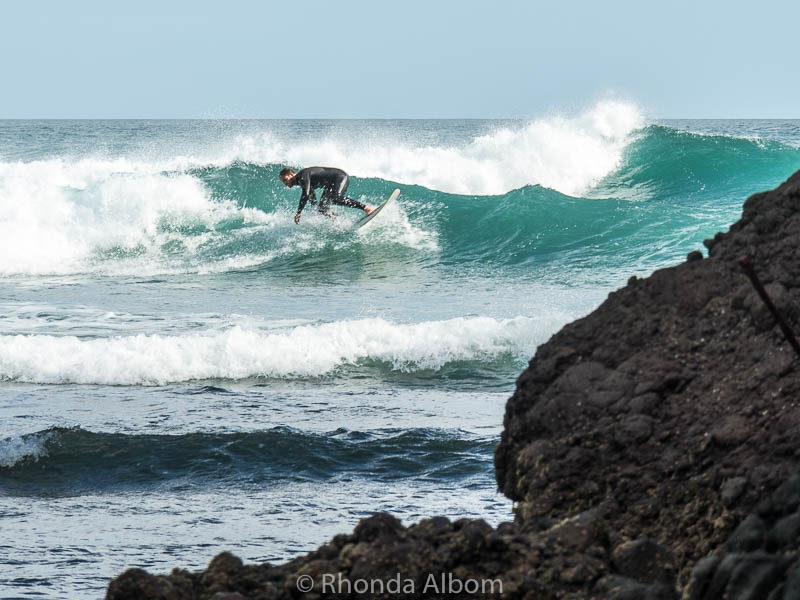 Surfing New Zealand at Little Piha beach in Auckland