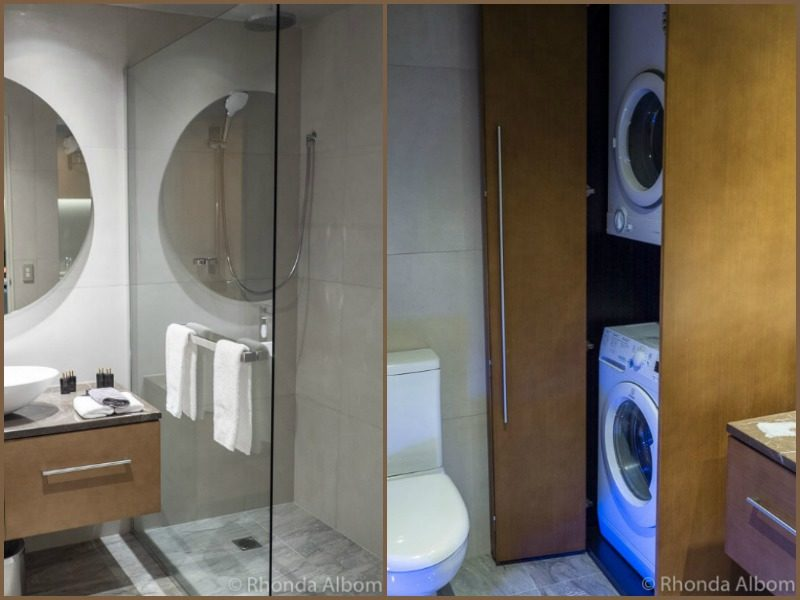 Shower, washing machine and dryer in the Distinction Hotel Dunedin New Zealand