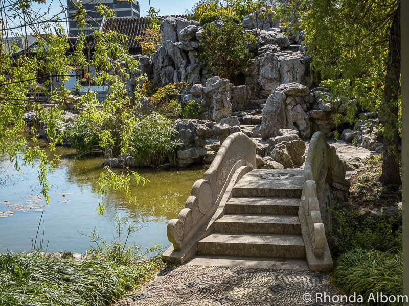 Rock path and bridge are part of the tranquil beauty at the Dunedin Chinese Garden New Zealand
