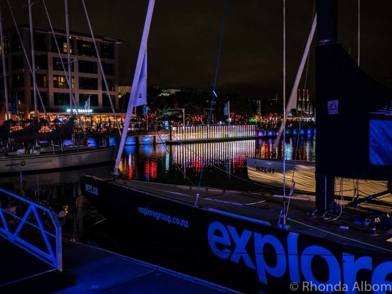 Former New Zealand Americas Cup boats seen during the light festival in Auckland at night.