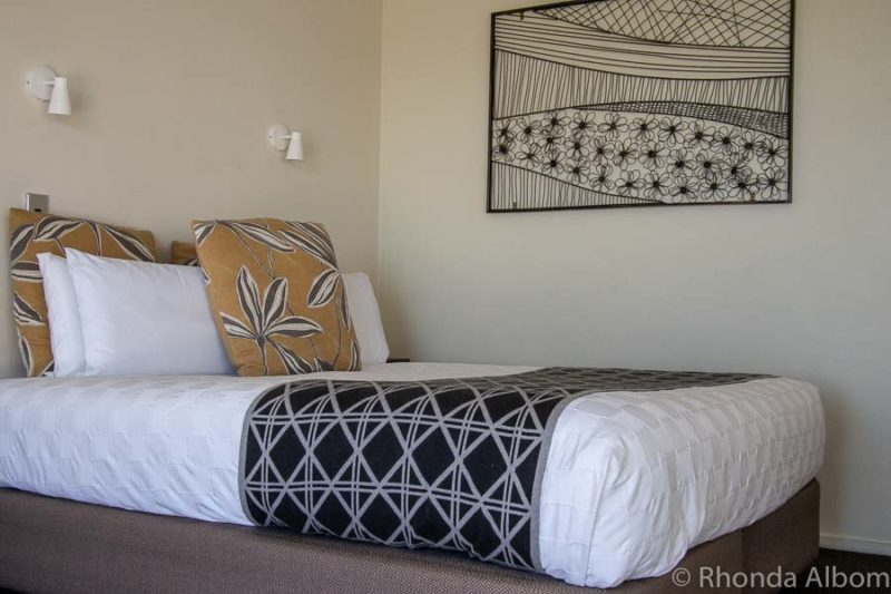 King bed inside with ocean view in our beach front villa at Papamoa Beach Resort
