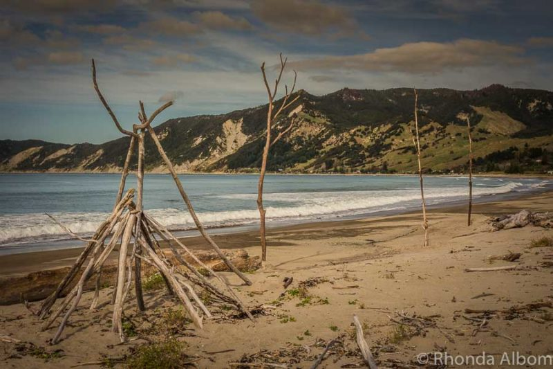 Driftwood art on the beach in Tokomaru Bay New Zealand
