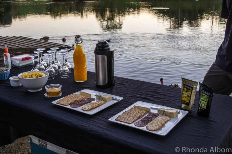 We were offered mulled wine, juice, cheese, and/or venison sausage as we watched sunset over Lake McLaren just before we set out on the Waimarino Kayak Glow Worm Tour