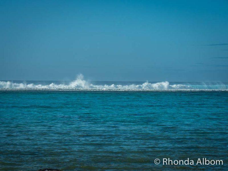 Waves breaking on reef seen from Moana Sands Lagoon Resort on Rarotonga, Cook Islands