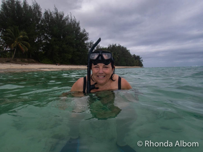 woman snorkelling at  Titikaveka Beach in the Cook Islands