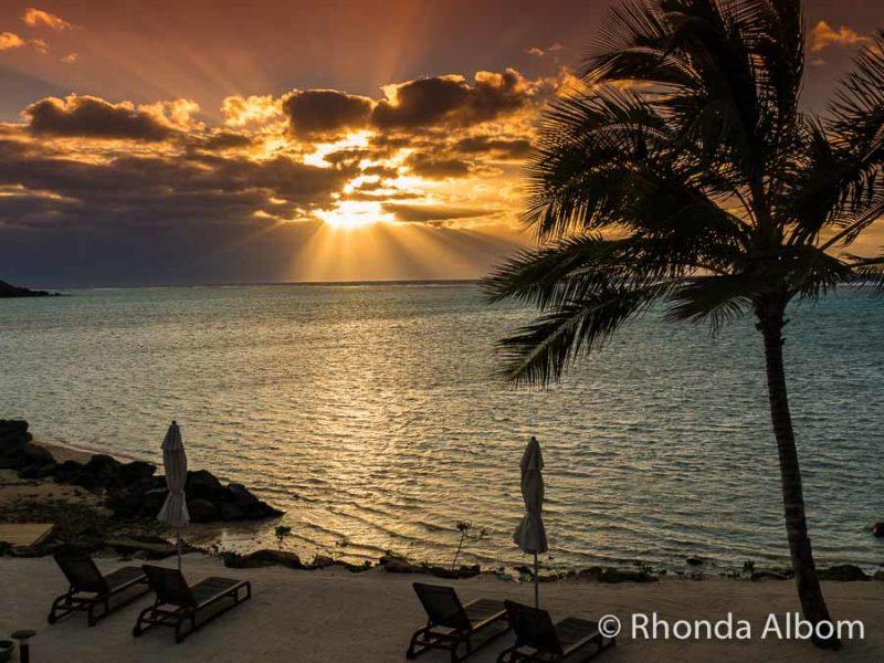 Deep orange sunrise over the ocean and seen from a Rarotonga beach resort