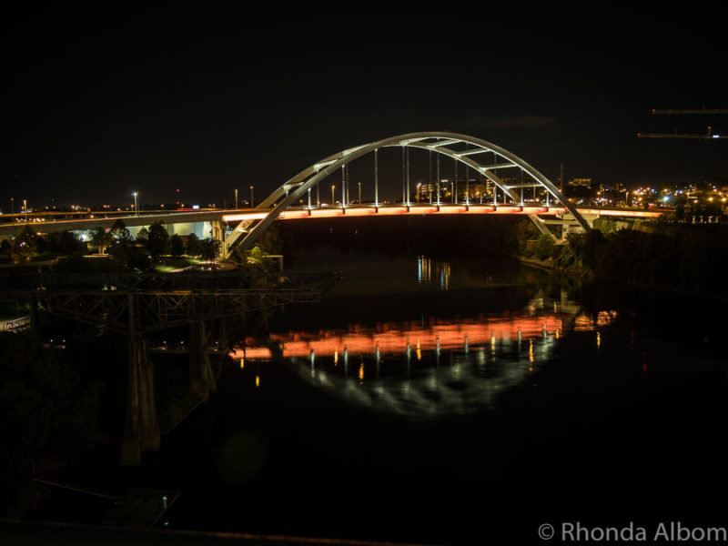 Another bridge reflecting in the water at night from John Seigenthaler Pedestrian Bridge in Tennessee