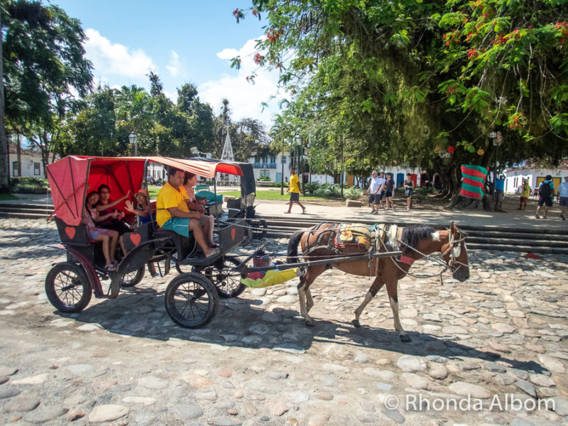 Horse drawn carriage in Matriz Square in Paraty Brazil