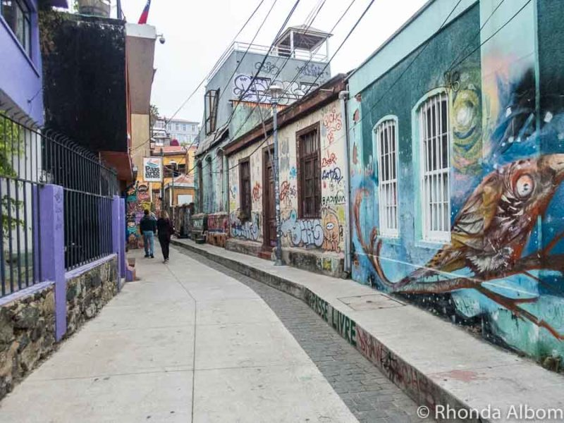 Street art vs graffiti on a Valparaiso Chile road