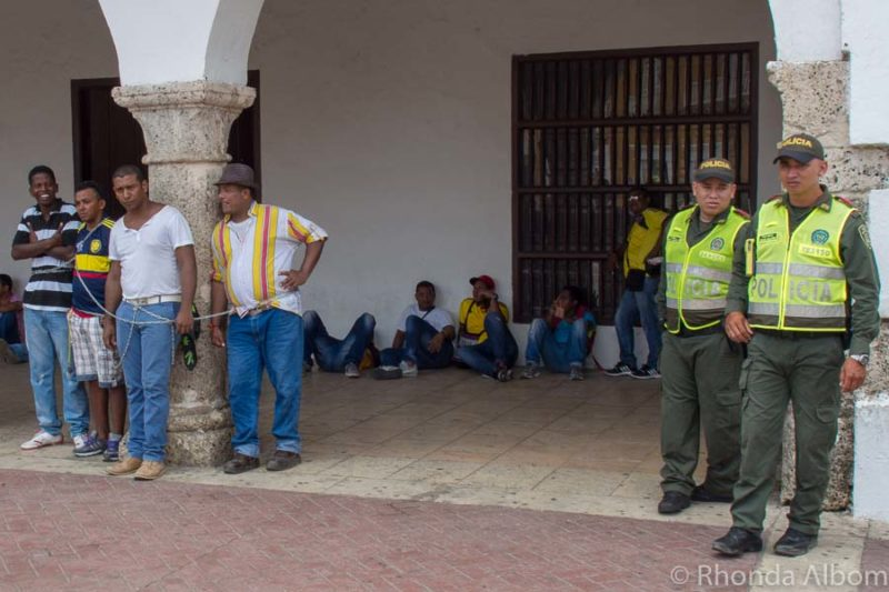 Protesters chain themselves to a building in Cartagena Colombia