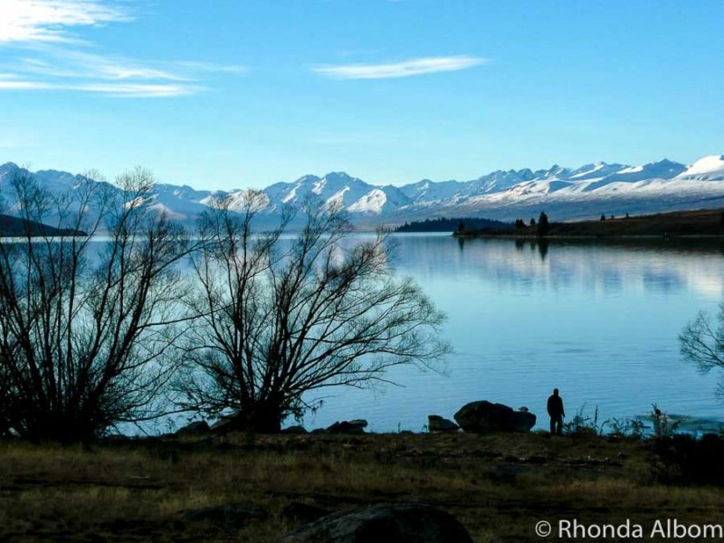 Walking along the shore is one of the many things to do in Lake Tekapo New Zealand