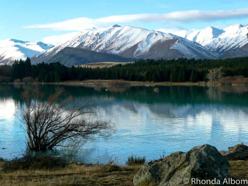 Snowcapped mountains reflecting in Lake Tekapo New Zealand