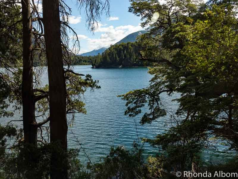 Views of Petito Moreno Lake while hiking on Sendero Arrayanes trail in Bariloche. Walking here is one of our many Argentina travel tips