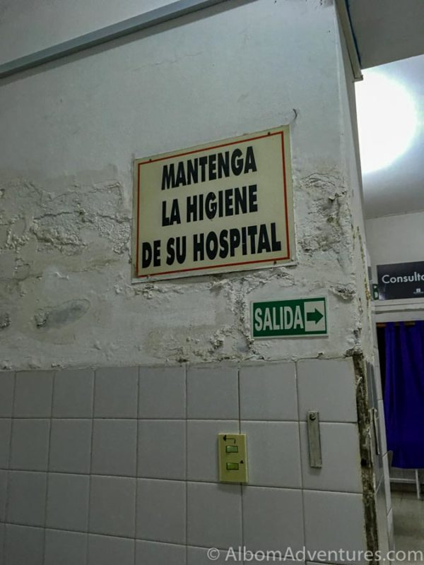 Sign on filthy wall translates to maintain hospital hygiene