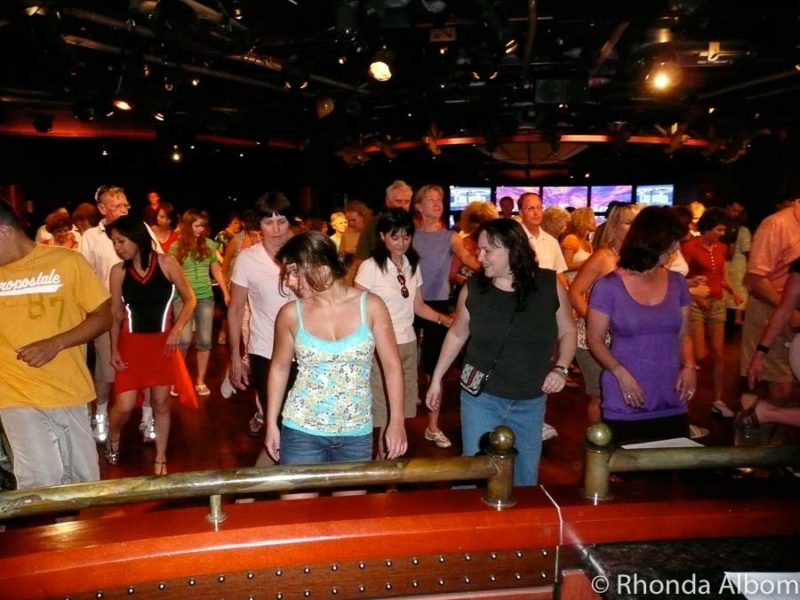Taking free classes like line dancing is one of the benefits of cruising