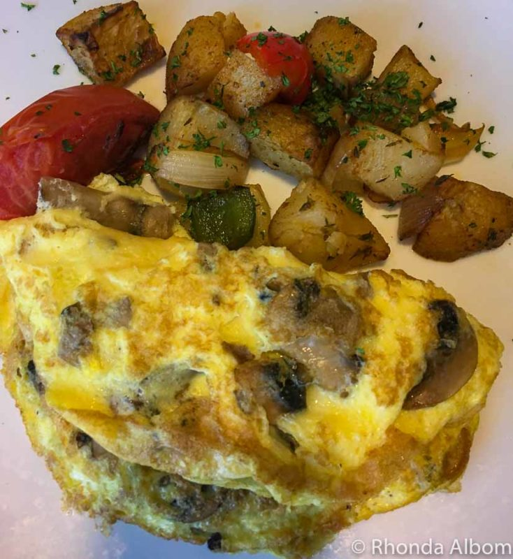 Omelette and potatoes with onion on Azamara Quest where I was unsuccessfully cruising with food allergies
