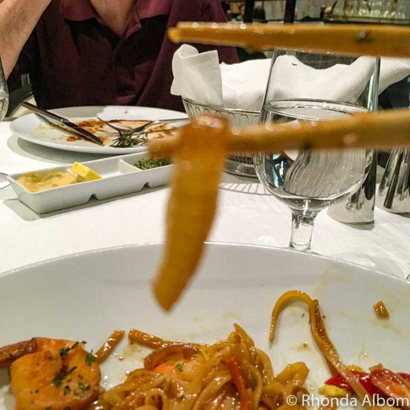 Slice of onion on a chop stick