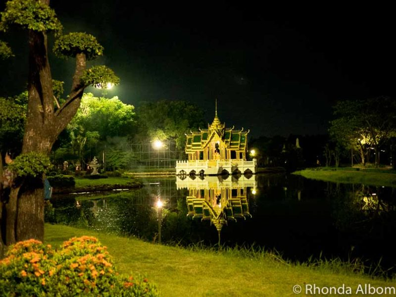 An intricate Thai structure at Ancient Siam lit up at night, seen during our 3 days in Bangkok