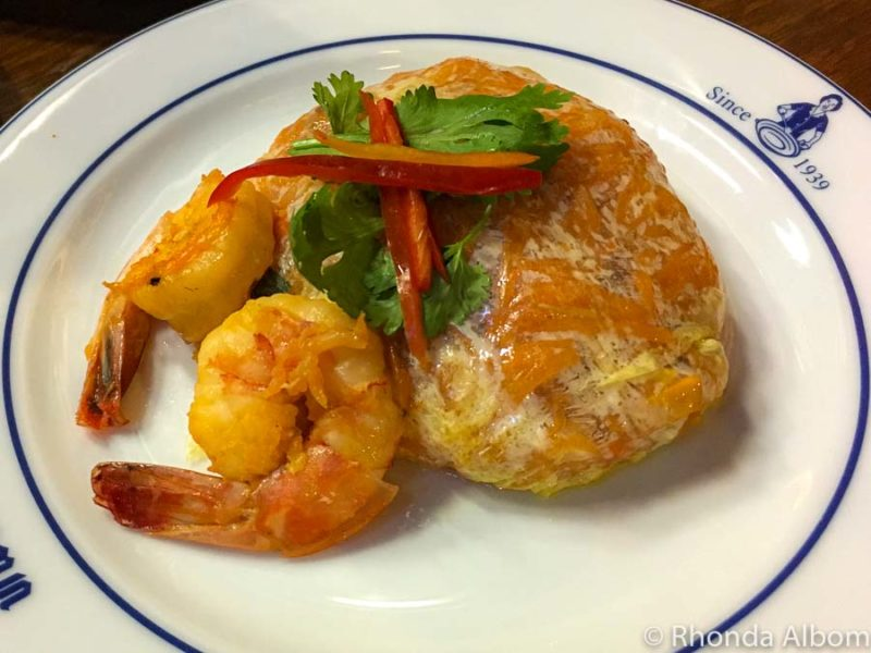 Egg wrapped pad thai and shrimp served in Bangkok Thailand