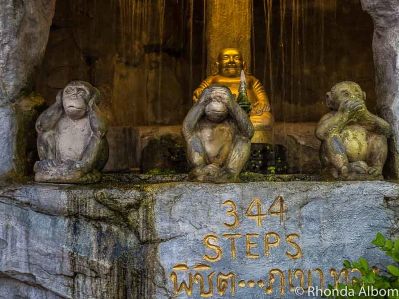 Hear no evil, see no evil, speak no evil monkey statues at the base of the Golden Mountain in Bangkok Thailand