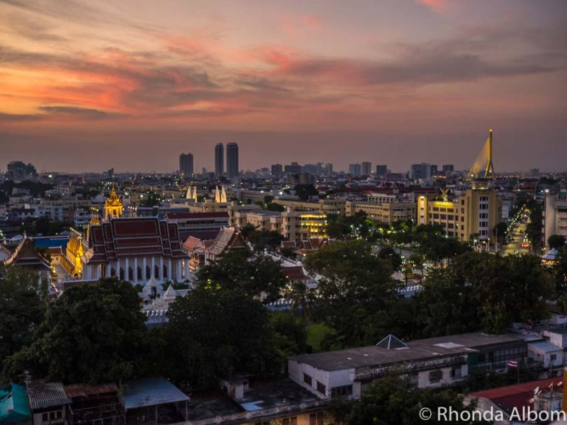 This colourful sunset seen from Golden Mountain in Bangkok, Thailand is one of the best things to do at night in Bangkok