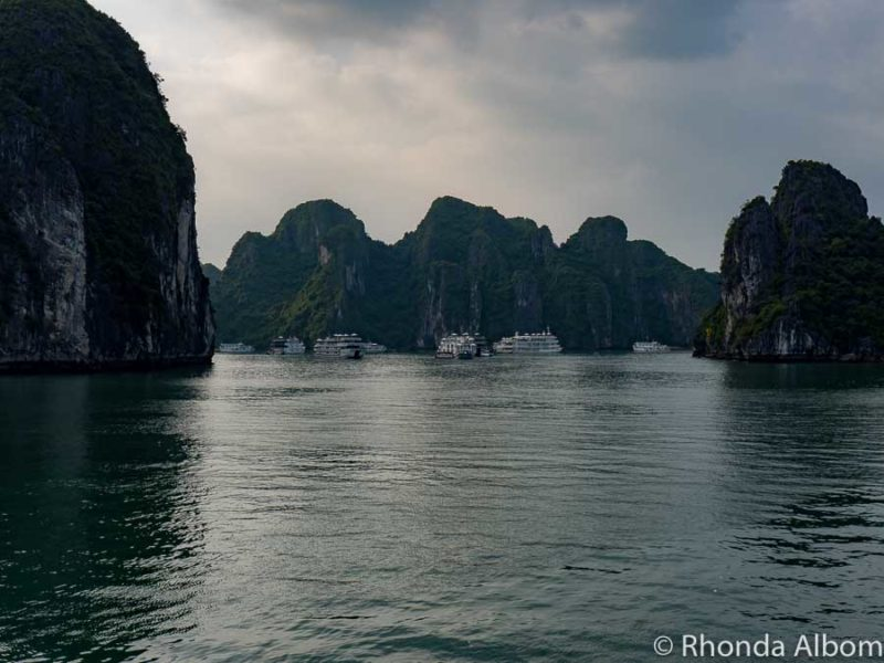 Too many boats in close proximity to each other in the distance seen from our Halong Bay Cruise in Vietnam