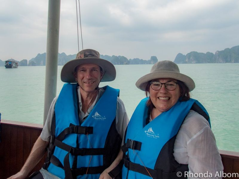 Jeff and Rhonda Albom on a small boat during their visit Halong Bay Vietnam.