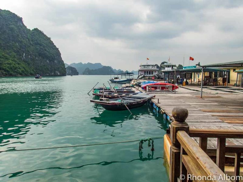 Bamboo boats and kayaks at a fishing village, a stop on our Halong Bay Cruise in Vietnam