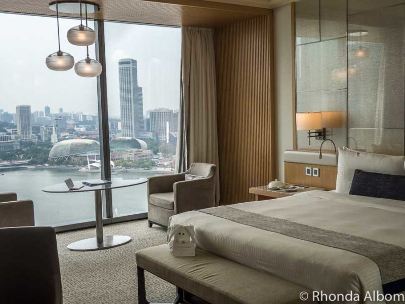 Floor to ceiling windows in our Premier King City View room in Marina Bay Sands Hotel in Singapore