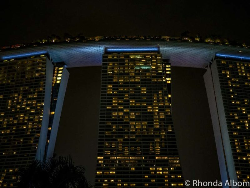 The famous hotel in Singapore lit up at night.