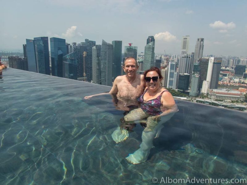 Jeff and Rhonda Albom in the world's largest infinity pool overlooking Singapore