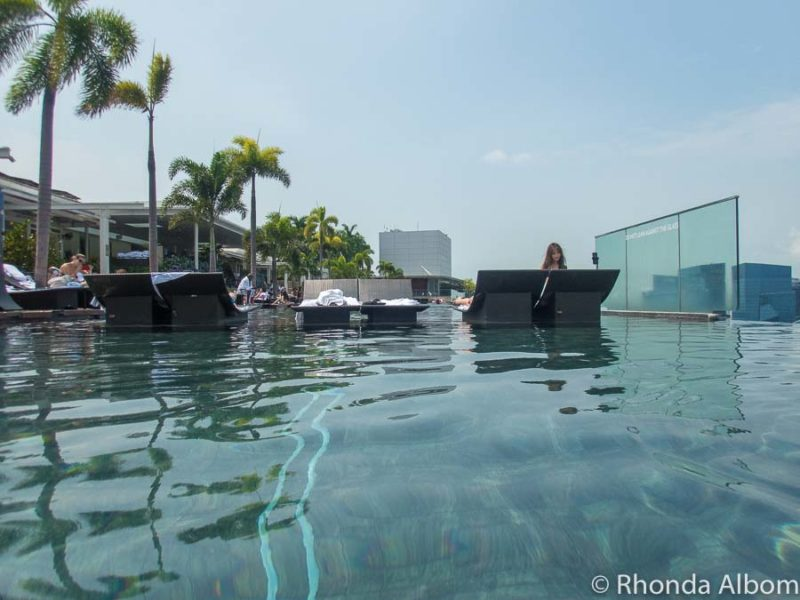 One guest with a selfie tripod in the Marina Bay Sands hotel pool