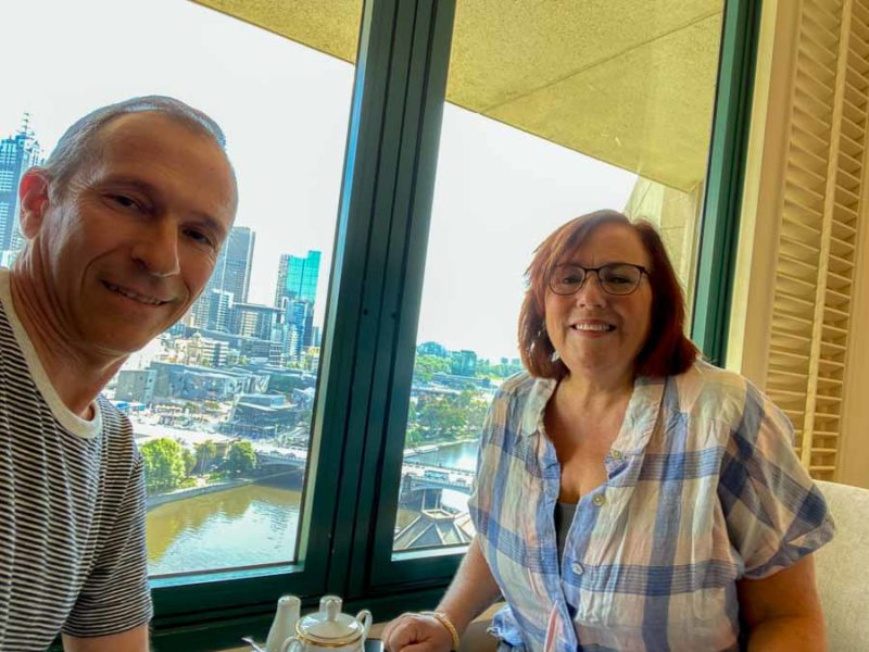 A selfie of Jeff and Rhonda Albom enjoying breakfast with a view of Melbourne from the 24th floor of one of the Langham, one of the best places to stay in Australia