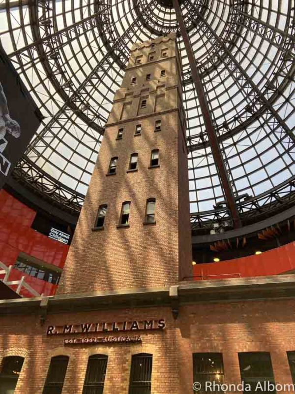 The tall Coop's Shot Tower is under a dome inside the Central train station in Melbourne