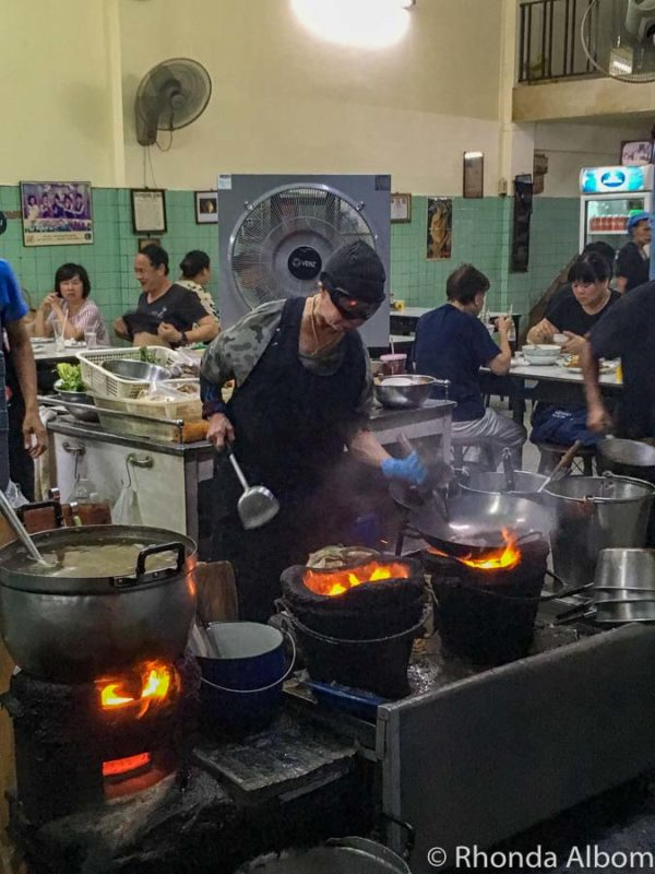 The owner and chef at Raan Jay Fai Restaurant in Bangkok wears goggles when she cooks