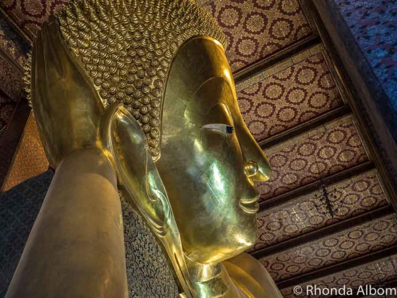 Golden head of the Reclining Buddha in Thailand