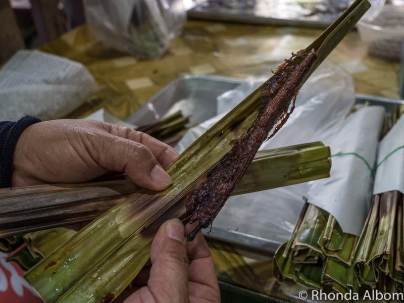 Barbecued coconut in palm leaf is one of my highlights of Bangkok food
