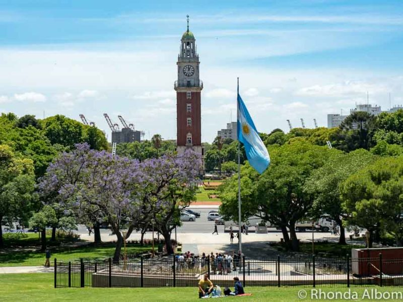 The flag of Argentina in Buenos Aires with the British-style clock tower in the background as part of our Argentina travel guide