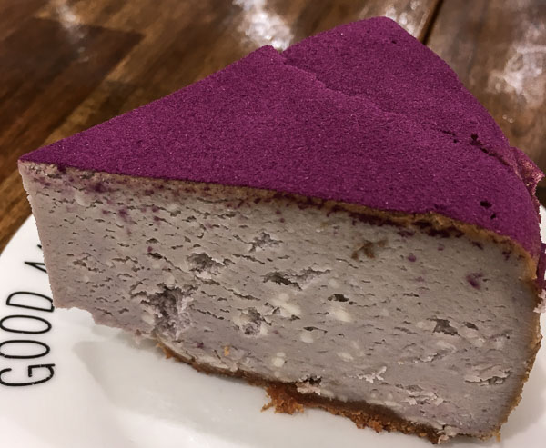 A slice of taro cheesecake with purple icing from one of the unique restaurants in Auckland New Zealand