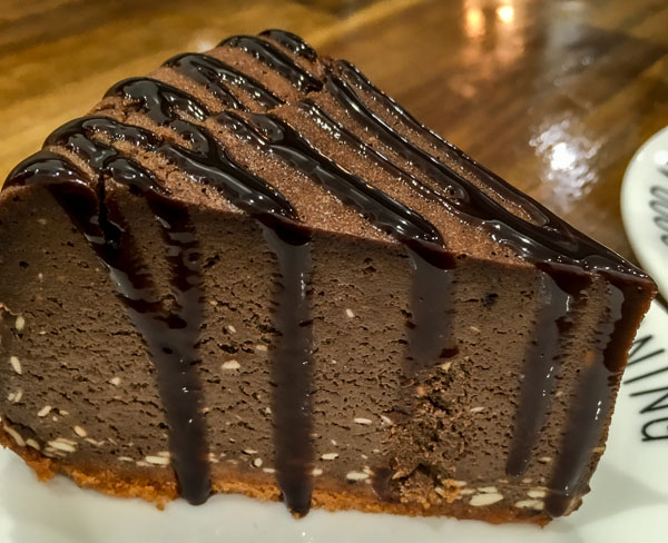 Chocolate caramel cheesecake with purple icing from Mellow Coffee and Desserts in New Zealand