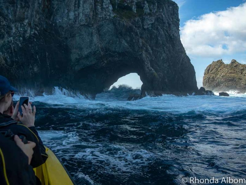 Big waves seen through the Hole in the Rock Bay of Islands
