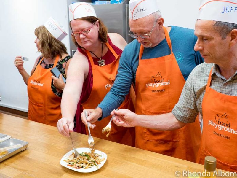 Students sample Char Kway Teow at a cooking workshop - Singapore