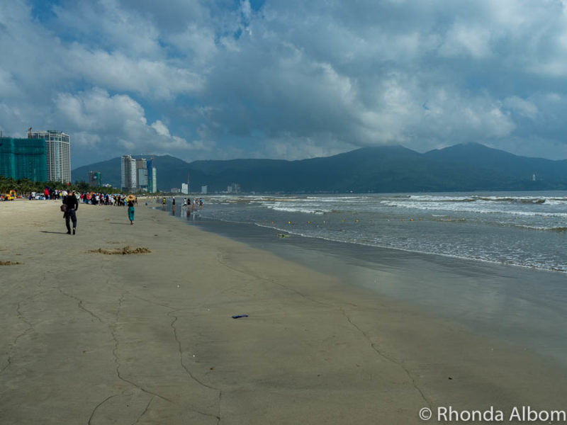 Looking down the long stretch of white sand and gentle waves at My Khe beach, once called China Beach Da Nang.
