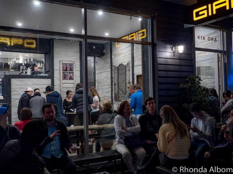 Crowds eating or waiting outside Giapo ice cream shop on an Auckland night in New Zealand