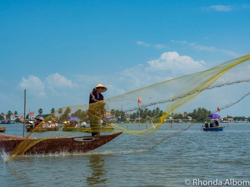 Watching a fisherman throwing net while on coconut boat is one of the many things to do in Hoi An, Vietnam