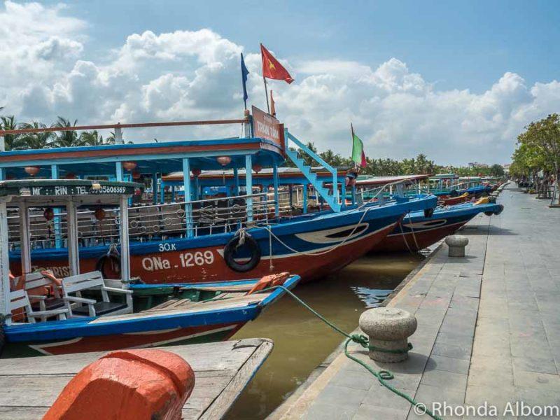 Boats along river in Hoi An, Vietnam