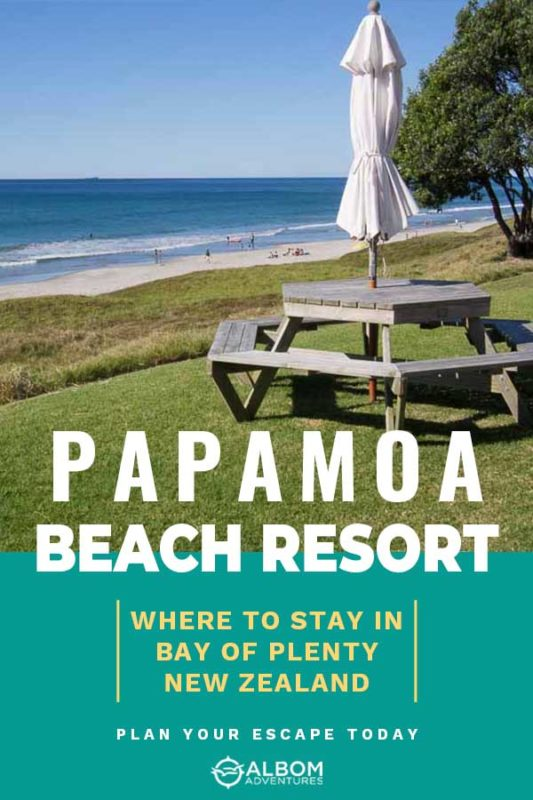 A view of the beach past a shared picnic table at Papamoa Beach Resort in the Bay of Plenty New Zealand