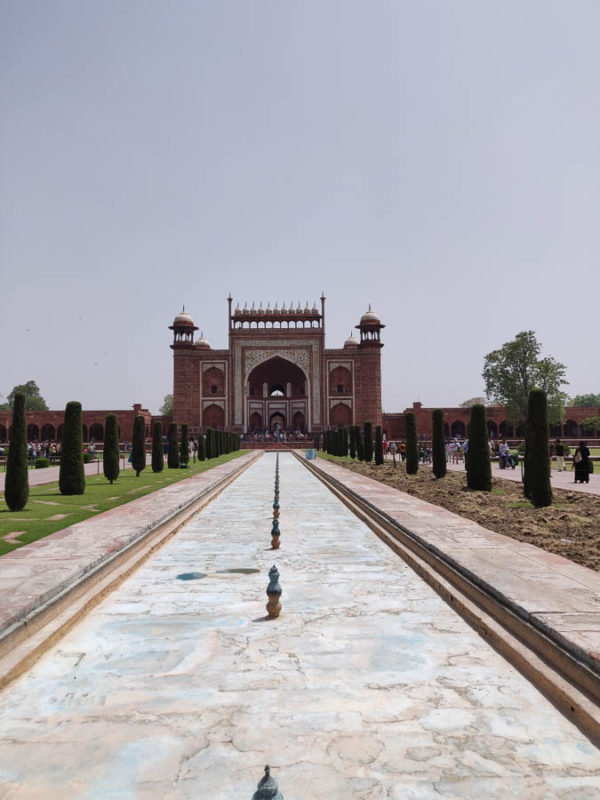 Looking along the long path leading back to the main gate of the Taj Mahal in India