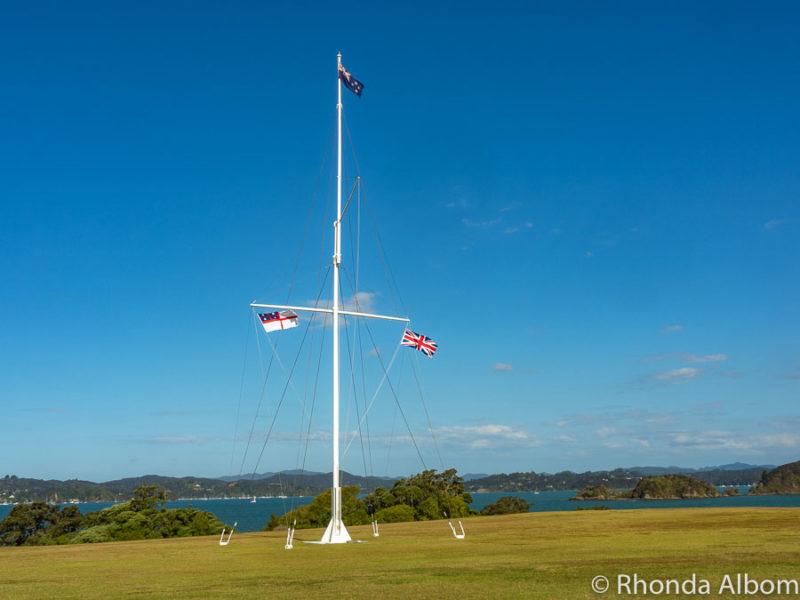 Flagstaff flying three flags at Waitangi New Zealand